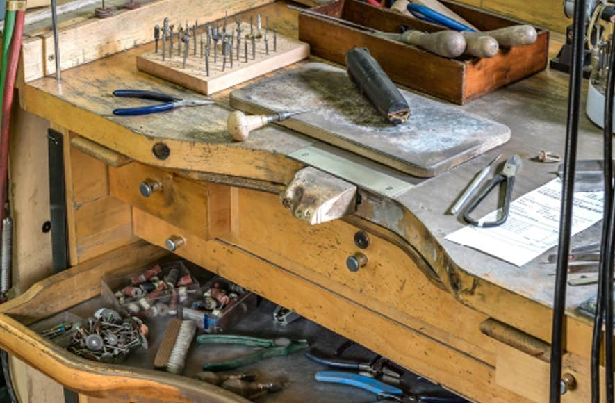 Looking at a jeweler's workstation with multiple trade tools