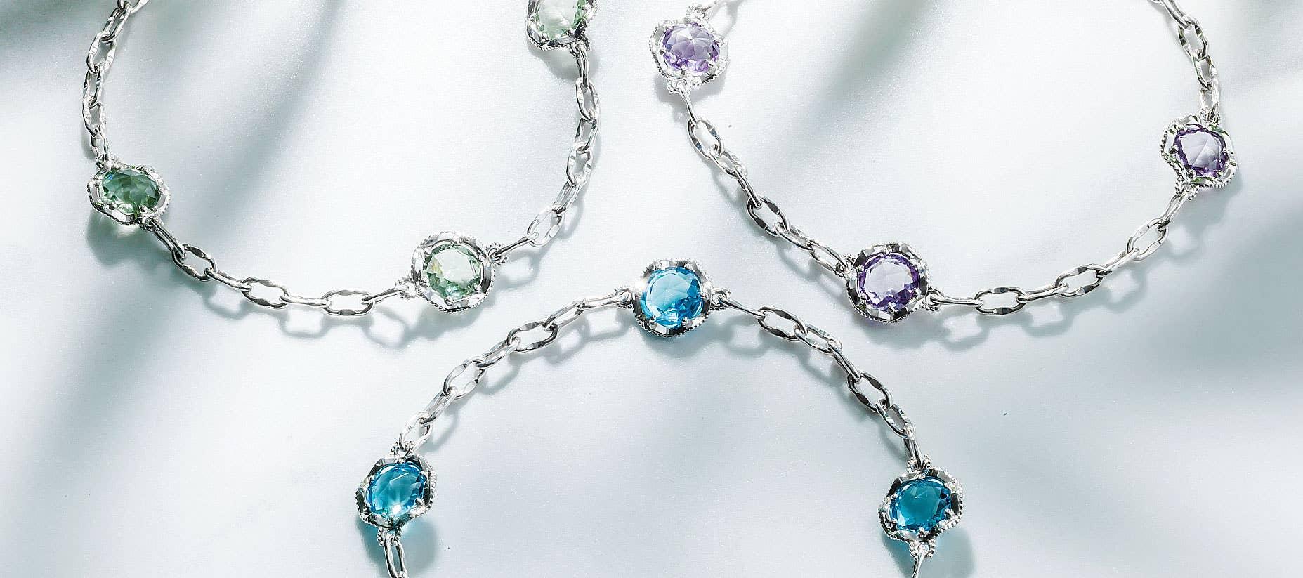 Three Tacori bracelets with multiple gemstones