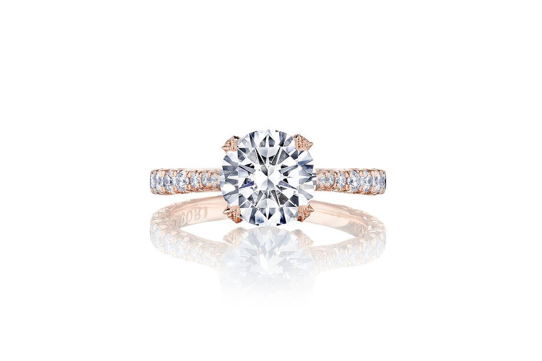 Round cut diamond engagement ring by Tacori on white background