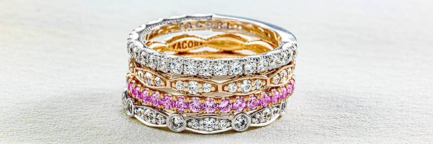 A stack of 4 Tacori rings featuring pink sapphire and diamonds