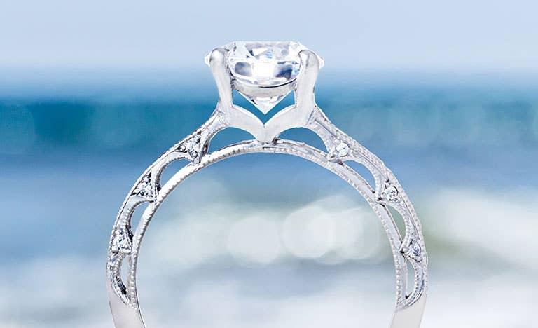 Reverse Crescent Engagement Rings
