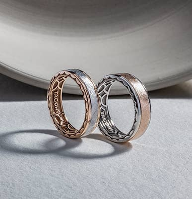 Matching pair of contrasting Tacori wedding bands with intricate inner-face